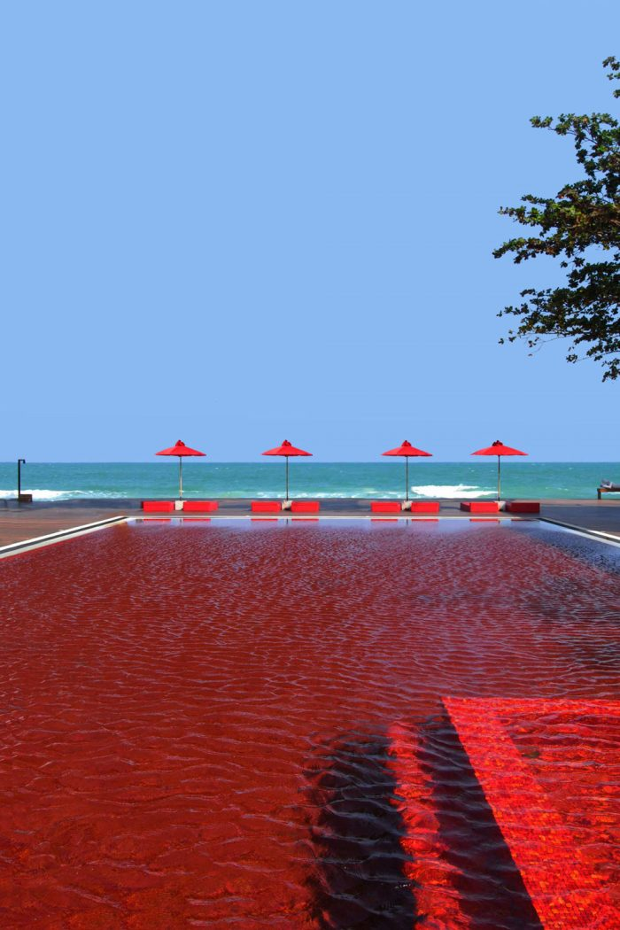 Unwind by The Library's signature red swimming pool with the lulling warm breeze of the pristine beach beyond. Selected as one of the world's most spectacular hotel pools by both Tripadvisor and Conde Nast, the Red Pool, with its mosaic tiles of orange, yellow and deep red, presents a dazzling spectacle of brilliant color and style.The Red Pool is just a few steps away from the white sandy beach of Chaweng that awaits you.