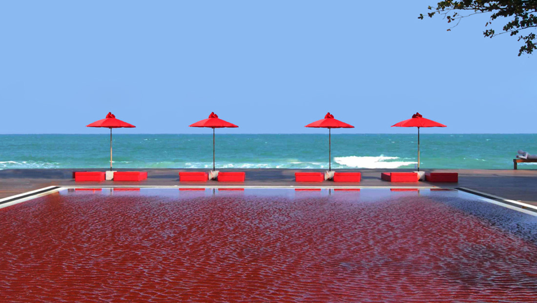 Unwind by The Library's signature red swimming pool with the lulling warm breeze of Chaweng Beach. Selected as one of the world's most spectacular hotel pools by both Tripadvisor and CNN, the Red Pool, with its mosaic tiles of orange, yellow and red, presents a dazzling spectacle of brilliant color and sophisticated style.